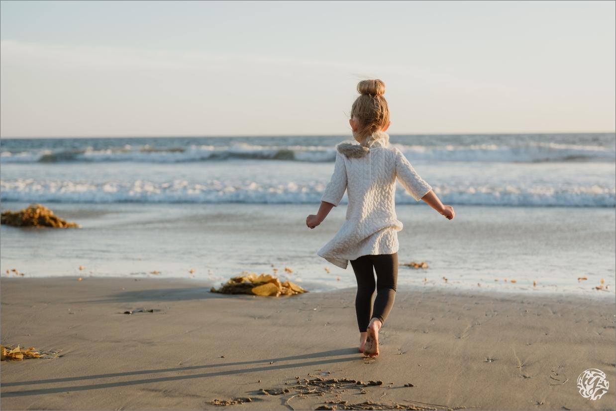 Yana's Photos - Los Angeles Family Beach Photographer - Girl running towards ocean.jpg