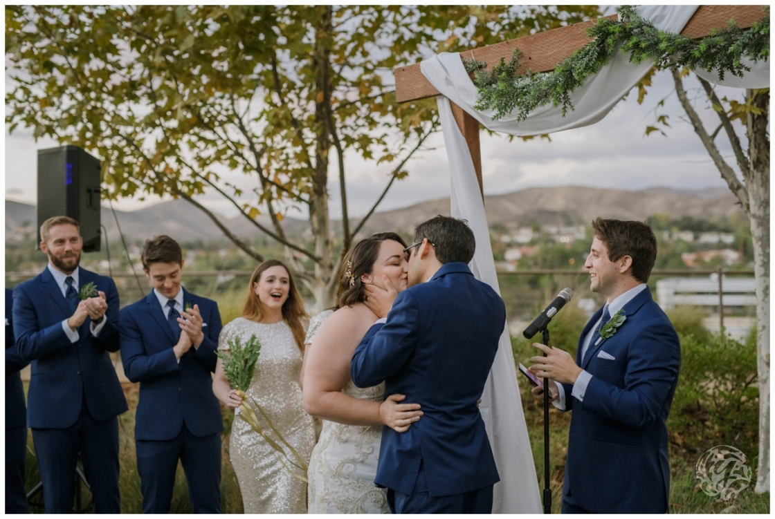 Outdoor Wedding Ceremony bride and groom kiss at Agoura Hills Recreation and Event Center Wedding